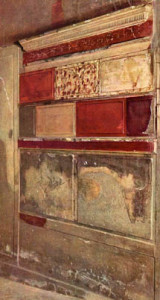 "First Style wall painting in the ""fauces"" of the Samnite House, Herculaneum, late second century BCE, imitated marble panels with stucco relief."