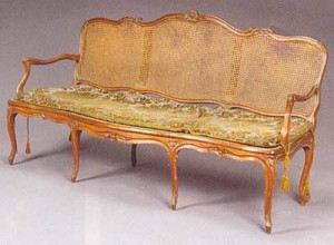 French, Provincial, Louis XV period, walnut and caned canapé