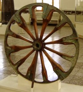 A spoked wheel on display at The National Museum of Iran, in Tehran. The wheel is dated to the late 2nd millennium BCE and was excavated at Choqa Zanbil.