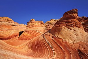 Red sandstone formation under blue sky, The Wave, Coyote Buttes, Paria Canyon, Vermilion Cliffs National Monument, Arizona, Southwest, USA, America.