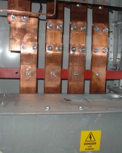 Copper is widely used for power distribution bus bars because of its high conductivity .