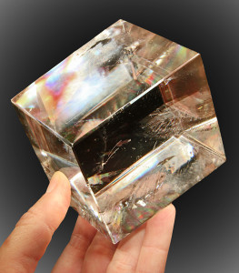 Iceland spar is a transparent crystalline form of calcite (calcium carbonate) that exhibits the property of double refraction, or birefringence.