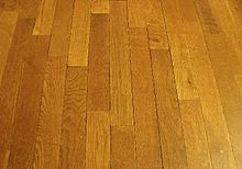 Wood can be cut into straight planks and made into a wood flooring.