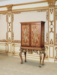 Armoire with wave-like motifs anf foliage