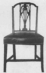 A sheraton style chair with rectangular back.