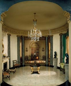 Model of an interior in Regency style with (foreground) a rotunda, presumably based on a design by Sir John Soane, and (background) a library, adapted from designs made in 1767 by Robert Adam for Kenwood House, London.