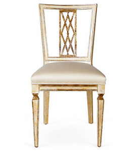 A sheraton style chair in white motifs.