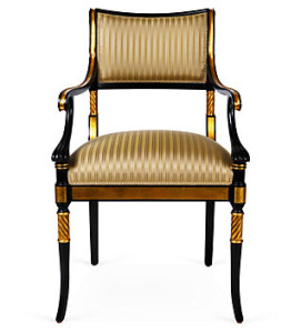 An Napoleonic Empire-style armchair with gilt and swept, scrolled arms.