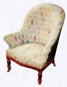 The squat armchair, completely covered with a tapestry, is a creation of the Louis-Philippe style.
