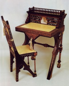 Writing desk and chair in black painted wood, metal inlaid and bone, lined with parchment