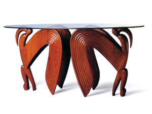 Judy Kensley McKie's Bird Table, 1983, edition of two, carved mahogany, penetrating oil finish, glass top