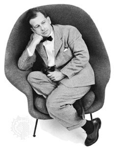 Eero Saarinen seated in a prototype of his Womb Chair. 1947