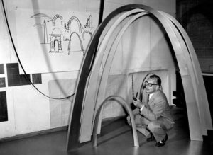 Eero Saarinen with model and sketches of the Jefferson National Expansion Memorial (Gateway Arch), St. Louis, MO, ca. 1958.