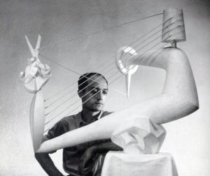 Isamu Noguchi with Carl Mackley Memorial, 1933.