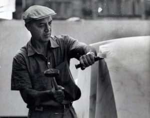 Isamu Noguchi working on marble element at the Sunken Garden at Yale, 1964.