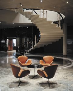 The hotel's curved staircase, a dramatic focal point, was at the edge of what was technically feasible at the time.