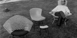 Harry Bertoia relaxes among a selection of his chair designs.