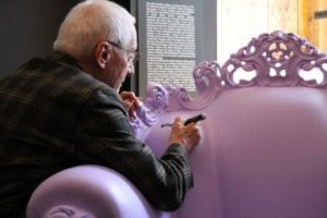Alessandro Mendini signs one of his Proust Armchair.