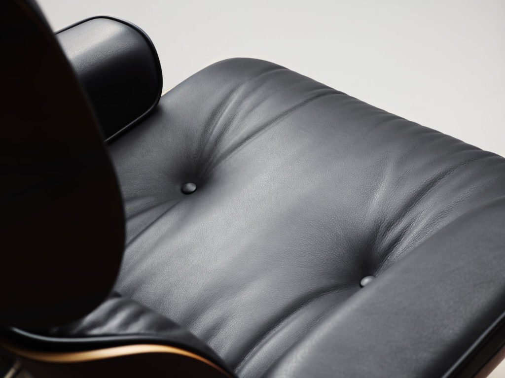 Detail of the upholstered leather cushion and the natural variations of the hide.