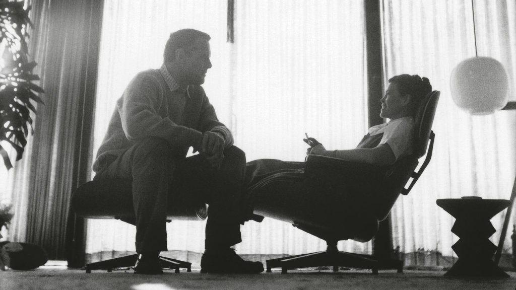 Charles and Ray Eames on the Lounge Chair & Ottoman.