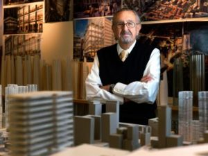 César Pelli with several miniatures of his designs.