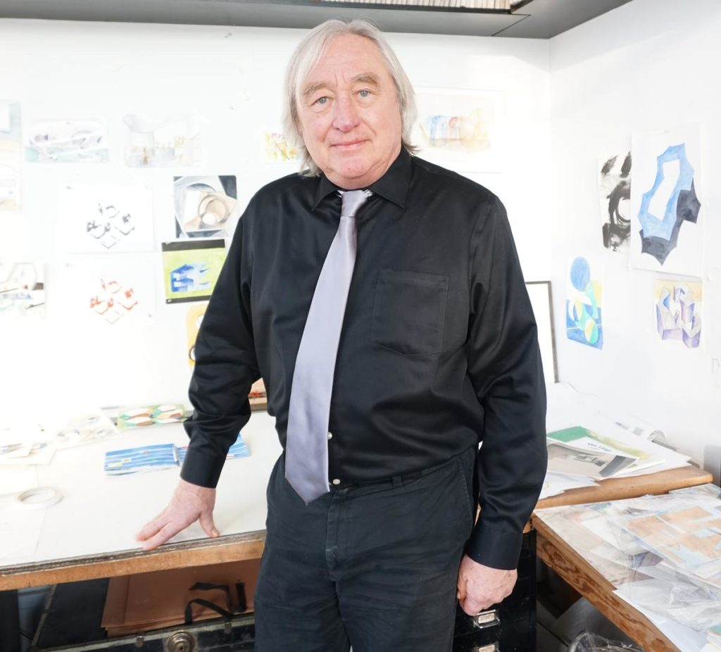 Steven Holl in front of his watercolor drawings that he uses to realize for every project.