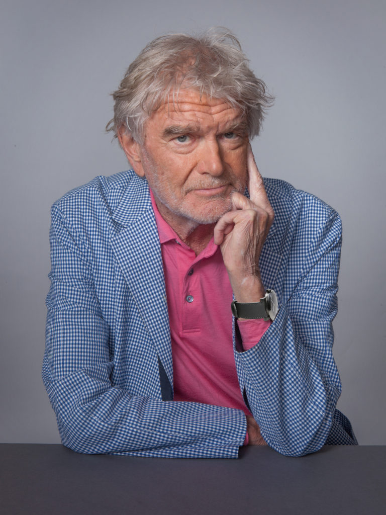 A portrait of the German-American industrial designer Hartmut Esslinger.