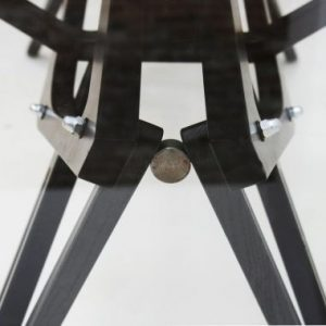 Detail of the metal joints system of the Reale table.