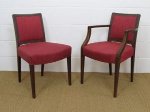 Two versions of the Cambridge Armchair, one with and one without the armrests, both with an upholstered backrest.