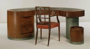 The Cambridge Armchair with the desk designed for the eye surgeon F. A. Williamson-Noble.