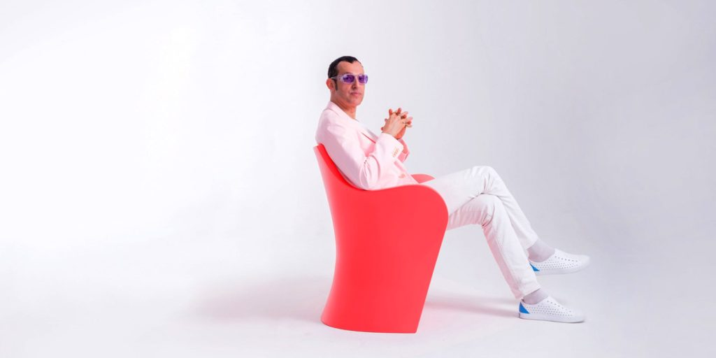 A portrait of the industrial designer Karim Rashid.