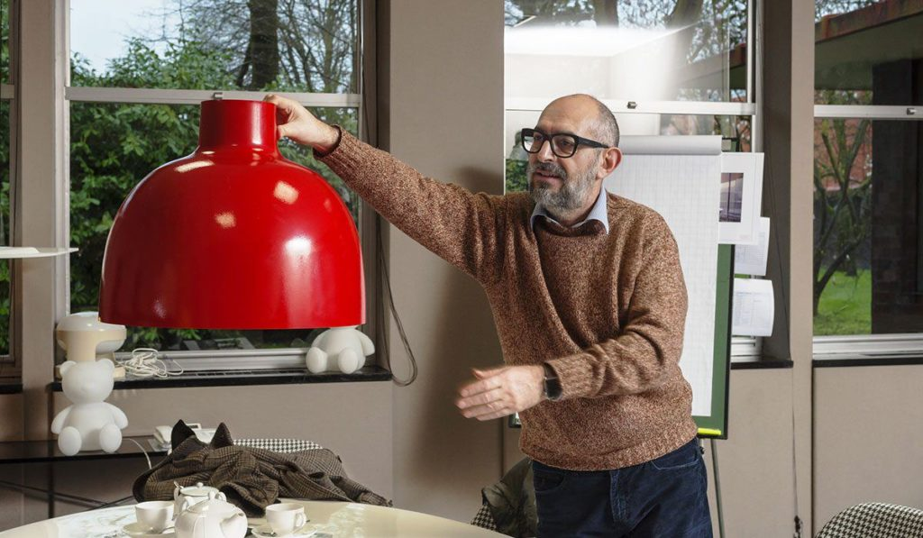 Ferruccio Laviani with one of his smart lamps designed for Kartell.