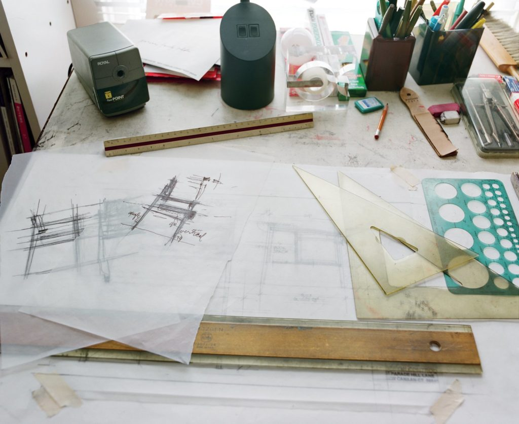 Risom's studios, with several drawings and concept shown on the desk.