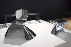 A display of Xavier Lust's 'archiduchaise chair', 'gun metal bench', and 'XST stool'.