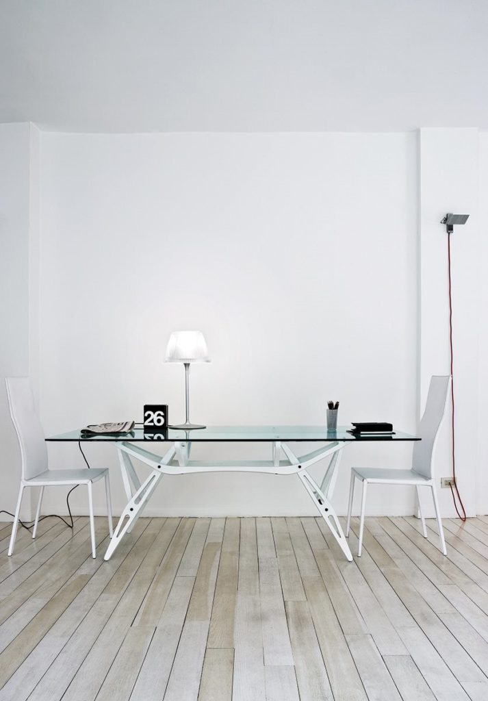 The visible, masterful structure of the Reale table by Carlo Mollino.