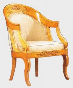 A typical chair made out of light wood.