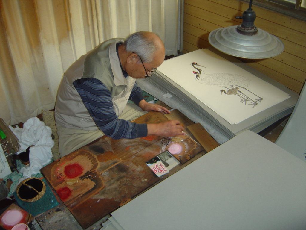 Japanese artists creating a popular ukiyo-e print.