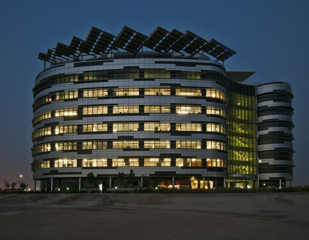 IRENA HQ, exterior. The structure was designed by Woods Bagot.