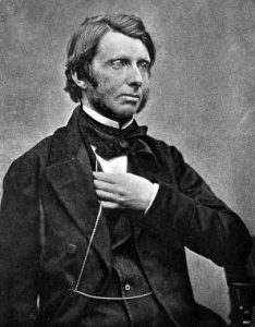 A portrait photograph of John Ruskin.